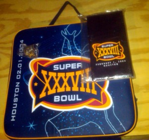 "A selection of some of the ""freebies"" ended out to reporters covering the Super Bowl. Photo R. Anderson"
