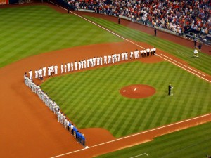 The Astros and Rangers observe the Opening Day tradition of being introduced on the field. Photo R. Anderson