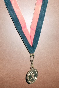 It is the time of year where students of all ages will be sporting graduation bling like this medal. Photo R. Anderson