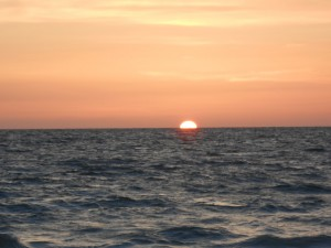 The sun sinking further under the waves. Photo R. Anderson
