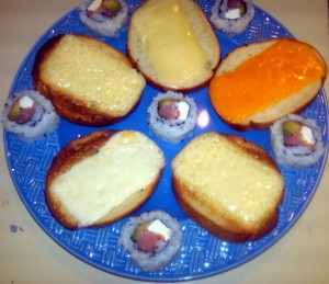 Assorted cheeses from Europe and Sushi may not be the all-American way to welcome a new NFL season but they do make a tasty snack. Photo R. Anderson