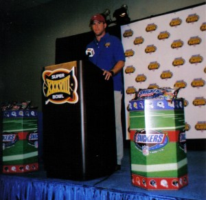 Brett Favre, shown here during an event for Snickers during Super Bowl XXXVIII made some people snicker when it was leaked that the St. Louis Rams were interested in the twice retired quarterback. For the record, Favre said no. Photo R. Anderson