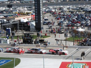 While it can be easy to forget there is a race going on inside with all of the fun happening outside the track Brad Keselowski (second car from right) won the Saturday race. Photo R. Anderson