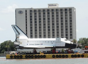"When the Space Shuttle Mock up arrived via water taxi it was sans ""tagging."" Last week someone changed that fact by spray paint the side of the mockup while it was sitting outside Space Center Houston. Photo R. Anderson"