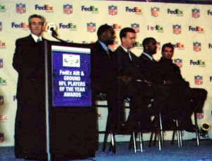 Peyton Manning spent Super Bowl XXXVIII on a panel with Joe Theismann, Michal Vick, and Daunte Culpepper. This year, as quarterback of the Denver Broncos he will have a much better seat. Photo R. Anderson