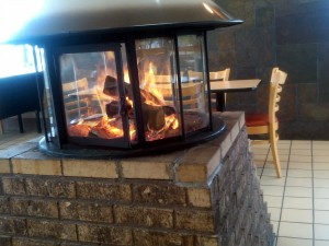 When the mercury drops a roaring fire can be just the thing to warm one to the core. This particular fire pit is inside a Dairy Queen which brings the heat and the cold. Photo R. Anderson