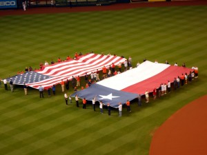 Opening nights in baseball such as the one last year between the Houston Astros and the Texas Rangers often feature large flags. Photo R. Anderson