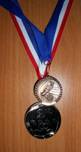 A few years back I took part in a 5k where everyone who showed up received the medal at the top. I earned the medal at the bottom through hard work and sweat and to me it is much more valuable than the other medal because it is something earned and not just handed to me. To much of society today seems to settle for just the showing up medal. Photo R. Anderson