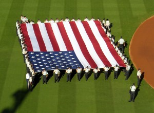Large flags and camouflage hats mark Memorial Day across Major League Baseball each year. Photo R. Anderson